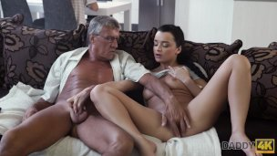 Daddy4k. Skillful Elderly Dude Controls To Pound Comely Brown-haired On Couch